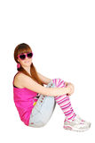 Teenage girl with sunglasses sitting Royalty Free Stock Photo