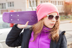 Teenage girl in sunglasses with skateboard Royalty Free Stock Photos
