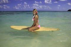 Teenage girl with surfboard Stock Photography
