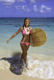 Teenage girl with surfboard Stock Images
