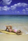 Teenage girl with surfboard Stock Image