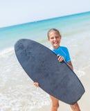 Teenage girl surfing Stock Photo