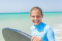 Teenage girl surfing Royalty Free Stock Images