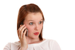 Teenage girl surprised by phone call Royalty Free Stock Photography