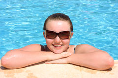 Teenage girl and swimming pool Stock Photography