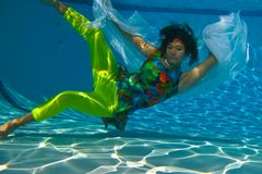 Teenage Girl Swimming With Veil Stock Photos