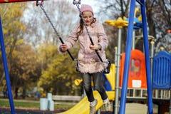 Teenage girl swingin on seesaw Stock Image