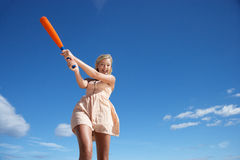 Teenage girl swinging baseball bat Royalty Free Stock Image