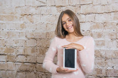 Teenage girl with tablet Stock Photo
