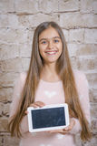 Teenage girl with tablet Royalty Free Stock Image