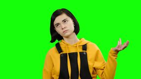Girl takes offense at her friend, turned away from him. Green screen. Teenage girl takes offense at her friend, turned away from him she is distressed. Green stock video