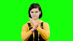 Girl takes offense at her friend, turned away from him. Green screen. Teenage girl takes offense at her friend, turned away from him she is distressed. Green stock footage