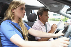 Teenage Girl Taking A Driving Lesson Royalty Free Stock Photos