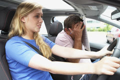 Teenage Girl Taking A Driving Lesson Stock Photography