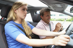 Teenage Girl Taking A Driving Lesson.  Stock Photos