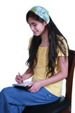 Teenage girl taking notes Royalty Free Stock Images