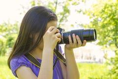 Teenage girl taking photos Stock Photography