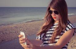 Teenage girl taking self portrait Royalty Free Stock Photo