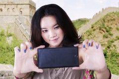 Teenage girl taking self portrait in China Stock Photo