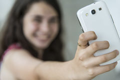 Teenage girl taking a selfie with her phone Stock Photos