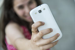 Teenage girl taking a selfie with her phone Stock Photo