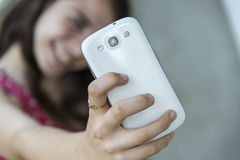 Teenage girl taking a selfie with her phone Royalty Free Stock Photos