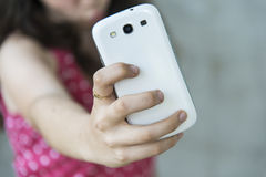Teenage girl taking a selfie with her phone Royalty Free Stock Photo