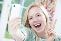 Teenage Girl Taking Selfie On Mobile Phone Stock Photo