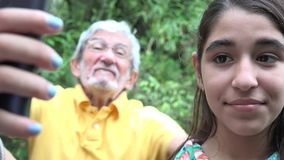 Teenage Girl Taking Selfie Photobomb stock video footage