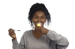 Teenage girl taking a yogurt Royalty Free Stock Image