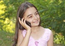 Teenage girl talking on cell phone. Beautiful teenage girl talking on cell phone royalty free stock photo