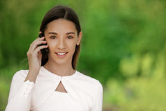 Teenage girl talking on cell phone Royalty Free Stock Photos