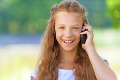 Teenage girl talking on mobile phone Royalty Free Stock Photo