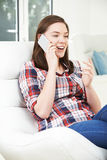 Teenage Girl Talking On Mobile Phone At Home Royalty Free Stock Images