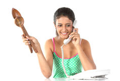 Teenage girl talking over telephon Stock Image