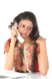Teenage girl talking over telephone Stock Photo