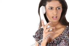 Teenage girl talking over telephone Stock Photos