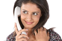 Teenage girl talking over telephone Royalty Free Stock Photos
