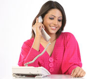 Teenage girl talking over telephone receiver Stock Photos