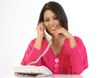 Teenage girl talking over telephone receiver Royalty Free Stock Photo