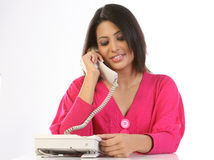 Teenage girl talking over telephone receiver Stock Images