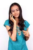 Teenage girl talking on phone Royalty Free Stock Photography