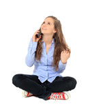 Teenage girl talking on the phone Stock Images