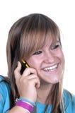 Teenage girl talking on the phone. On white background Royalty Free Stock Photos