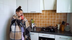 Teenage girl talking on phone and drinking tea in isolation at home