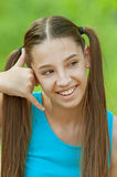 Teenage girl talking on virtual cell phone Royalty Free Stock Image