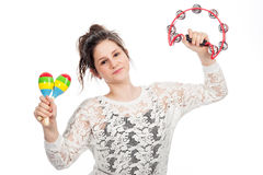 Teenage girl with tambourine and maracas. Pretty teenage girl shaking tambourine and maracas in studio on white background Royalty Free Stock Photos