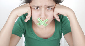 Teenage girl with taped mouth Stock Photography