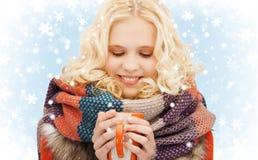 Teenage girl with tea or coffee mug Stock Images