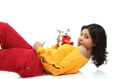 Teenage girl  with teddy bear. Teenage girl playing with small teddy bear Stock Photos